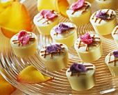 Mascarpone & cassis chocolates with candied flower petals