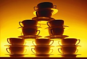 Pile of soup plates with yellow lighting
