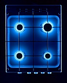 Gas cooker with blue flames from above
