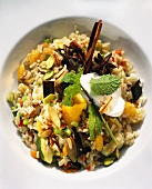 Pilau with spices, vegetables, apricots and yoghurt