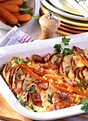 Bread casserole (Ofenschlupfer) with carrots and bacon