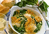 Haddock with spinach crust in a gratin dish