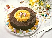 Chocolate cake, decorated with Easter sweets