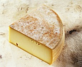 French Fromage a Raclette on light brown background