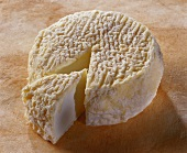 Lunaire, a French goat's cheese, on brown background