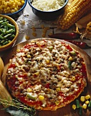 Pizza with sweetcorn and green beans on wooden plate