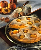 Quick fruit sponge with peaches and icing sugar