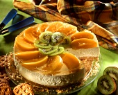 Cheesecake with peaches and kiwi fruits