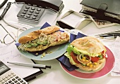 Two healthy sandwiches on an office desk