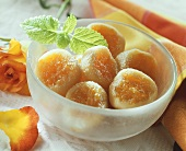 Apricot drops in a bowl with mint leaf