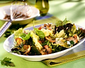 Salad leaves in tomato vinaigrette with brown mushrooms