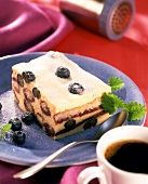 Quark tiramisu with blueberries and lemon balm; coffee