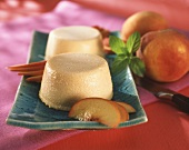 Peach yoghurt mousse with peach slices on plate