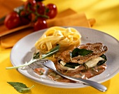 Veal steaks with sage and mozzarella stuffing and noodles