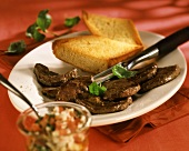 Barbecued beef fillets with garlic baguette & tomato pesto