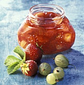 Gooseberry and strawberry jam in a jam jar