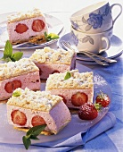 Strawberry and Prosecco cream cakes on a plate; coffee cups
