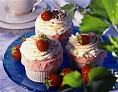 Iced strawberry soufflés with cream and fresh strawberries