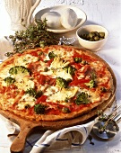 Pizza con verdure e prosciutto (Ham and vegetable pizza)