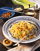 Pan-cooked cabbage dish with rice, pumpkin and raisins