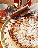 Almond & cinnamon tart with toasted almonds & icing sugar
