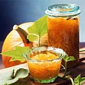 Pumpkin and citrus fruit preserve in jar and bowl