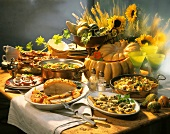 Rustic buffet for Harvest Festival on wooden table