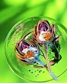 Two stuffed artichokes with sour cream and caviare