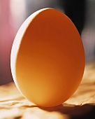 A white egg, standing up, with orange lighting