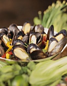 Steamed mussels with pepper strips in a bowl