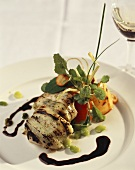Chicken breast in leek with balsamic sauce and vegetables