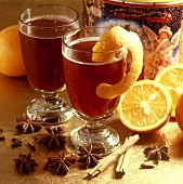 Two glasses of red wine punch with orange peel