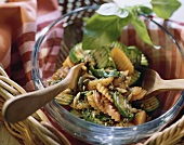 Courgette and carrot salad with pumpkin seeds in glass dish