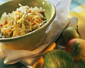 Bavarian cabbage with bacon and apples in green dish