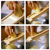 Making cucumber salad: shaving off cucumber slices