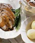 Braised pickled beef with potato dumplings & gravy
