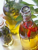 Home-made oils: chili oil, herb oil and juniper oil