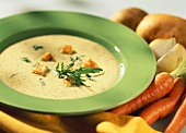 Carrot soup with rocket and croutons