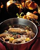 Coq au vin in a stew pot