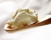 Crème fraiche on a wooden spoon