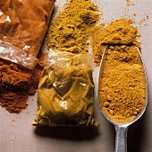 Curry powder in small bag and on a scoop