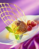 Praline balls with raspberries and wafer lattice