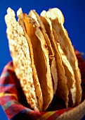 Wheat tortillas in a bread basket
