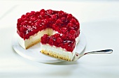 Raspberry cream gateau with piece on cake slice