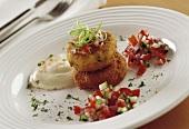 Fishcake with tomato salsa and aioli on a plate