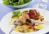 Roast pork on polenta with basil