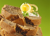 Slices of green rye bread, in a pile