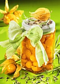 Physalis compote with lavender in preserving jar with bow