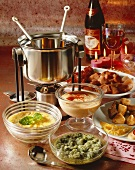 Meat fondue with three dips and wine