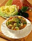Pot au feu with savoy and beef in a soup cup